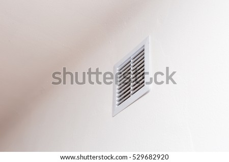 Close up of vent on the white wall. Plastic ventilation grid, piece of home ventilation system.