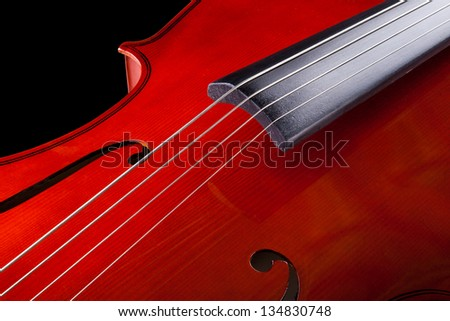 Close-up Of Vintage Cello Over Black Background - stock photo