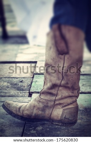 Close up of vintage cowboy boots - stock photo