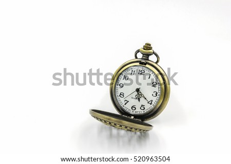 Close up of vintage golden pocket watch isolated on white background.