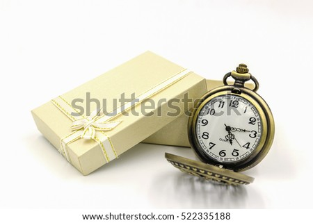 Close up of vintage golden pocket watch with Mulberry paper gift box isolated on white background.