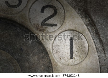 Close up of Vintage phone dial, dirty and scratched - 1 - stock photo