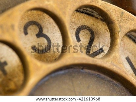 Close up of Vintage phone dial, dirty and scratched - 2, perspective - stock photo