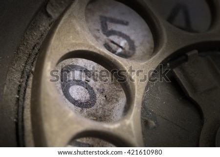 Close up of Vintage phone dial, dirty and scratched - 6, perspective - stock photo