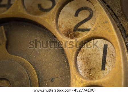 Close up of Vintage phone dial, dirty and scratched - 1, perspective - stock photo