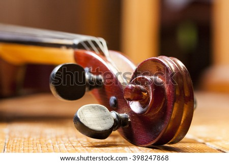 Close up of vintage violin on sheet music background - stock photo