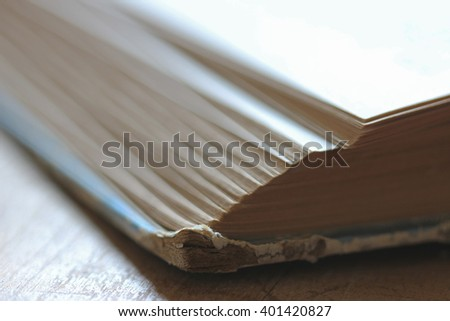 Close up of vintage well-worn book edge for background