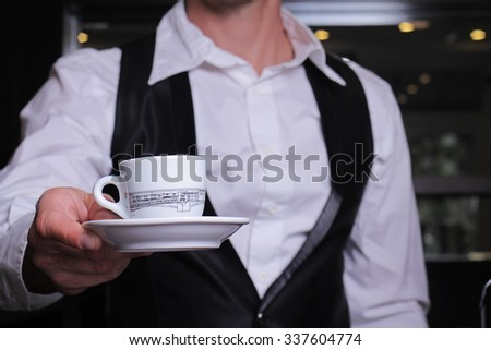 Close up of waiter serving coffee espresso cup. High standard of  Service. Restaurant concept