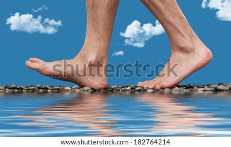 Close up of walking feet  - stock photo