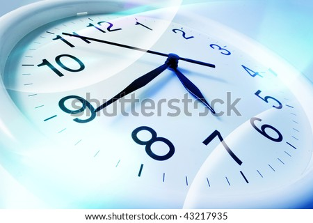 Close Up of Wall Clock in Blue Tone - stock photo