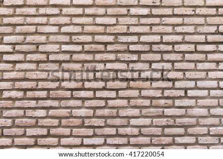 Close-up of wall made of bricks and cement - stock photo