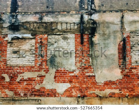 Close up of wall made of bricks at ruins of old industrial building. Can be used as background.