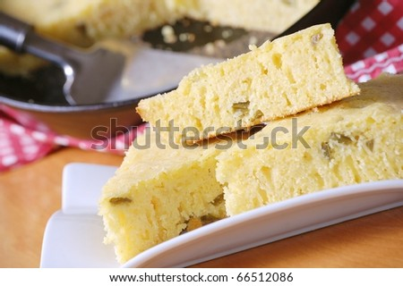 Close Up of Warm Jalapeno Cornbread on a White Plate - stock photo