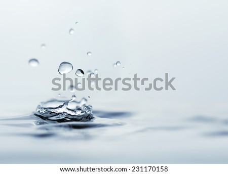 close up of water droplets over wet surface - stock photo