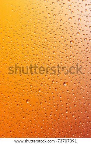 Close-up of water drops on textured metallic surface as background. - stock photo