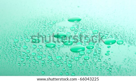 Close up of water drops with shallow depth of field in green - stock photo