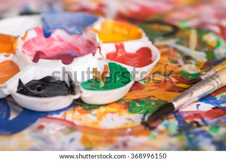 Close up of water multicolors with painting brushes for art learning background - stock photo