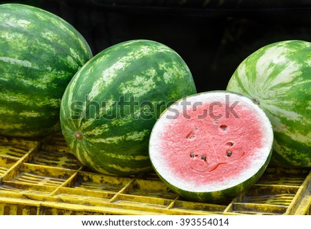 Close up of watermelons on a road side produce vending post. - stock photo