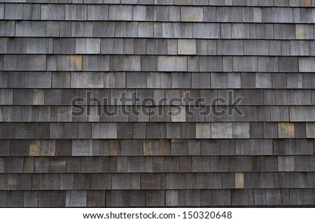 Close up of Weathered Cedar Shingled Wall on Ocean Front House - stock photo