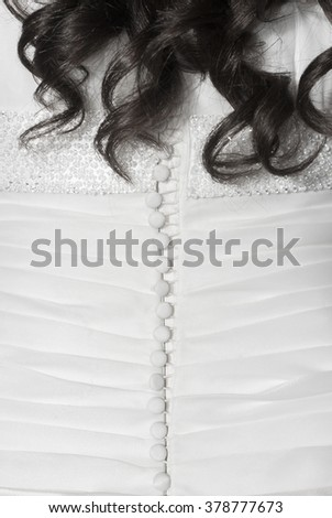 close-up of wedding dress detail and bride hairs
