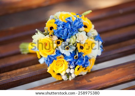 Close up of wedding yellow blue ukranian bouquet - stock photo