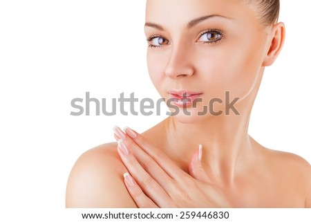 Close-up of well-groomed young woman isolated on white background - stock photo