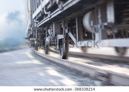 close up of wheels of train in blurred motion