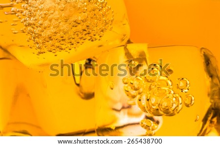close-up of whiskey in glass with ice used for background, whisy texture - stock photo