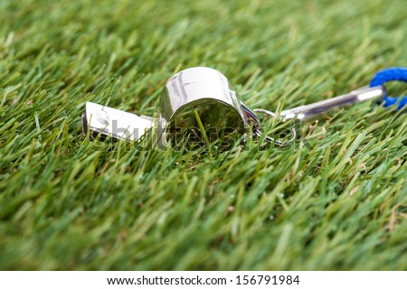 Close-up Of Whistle On The Green Field - stock photo
