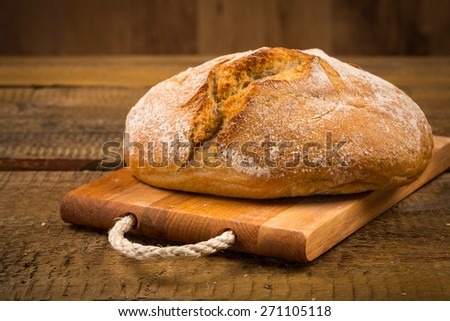 Close up of white bread over wooden background - stock photo
