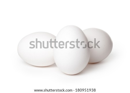 Close-up of white chicken eggs isolated on a white background with soft shadow. Clipping path included - stock photo