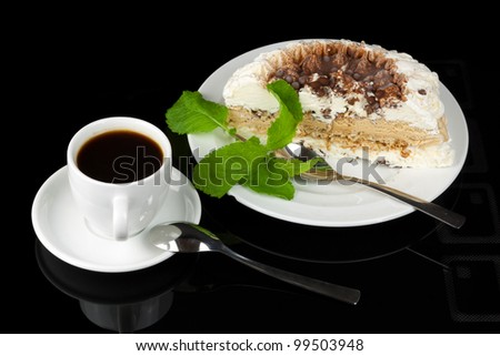 Close-up of white cup of coffee and ice cream cake - stock photo