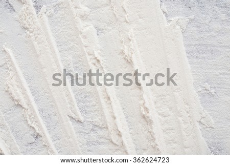 close up of white flour on wooden background