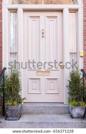 Close up of white front door of a luxury house
