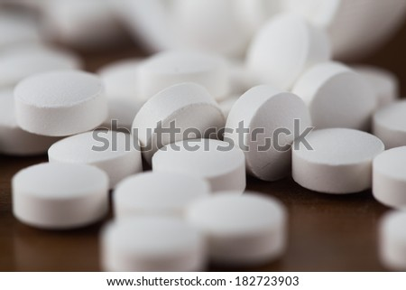 Close up of white pills.