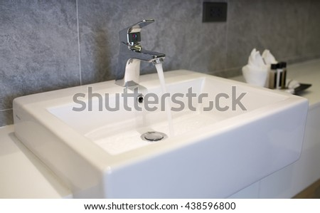 Close-up of white porcelain square basin in new bathroom - stock photo