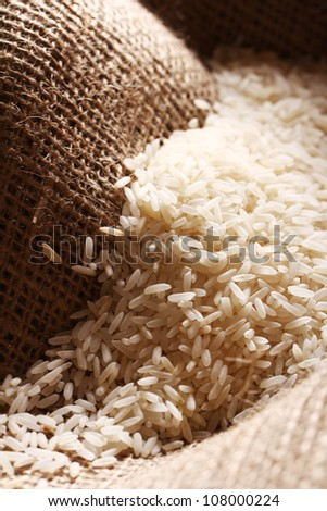 Close up of white rice grains on the sack cloth