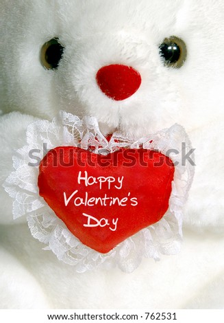 "Close-up of white teddy bear with ""Happy Valentine's Day"" heart"