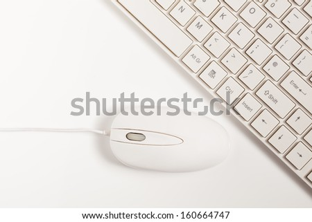Close up of white wireless keyboard  and wired mouse for concepts of digital information technology media and the internet