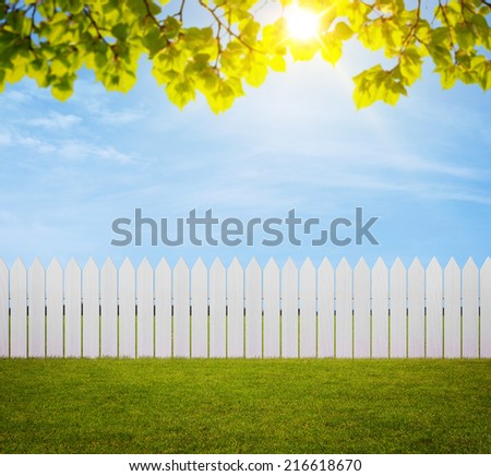 Close up of white wooden fence in the back yard with copy space - stock photo