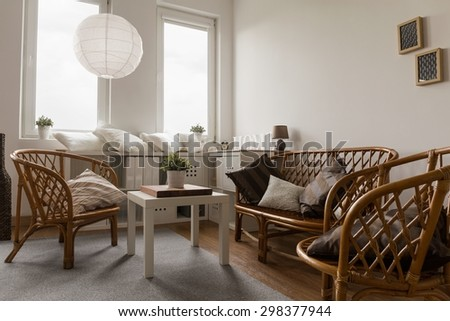Close-up of wicker furniture in living room - stock photo