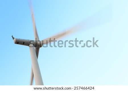 Close up of Wind turbine generating electricity, alternative energy - stock photo