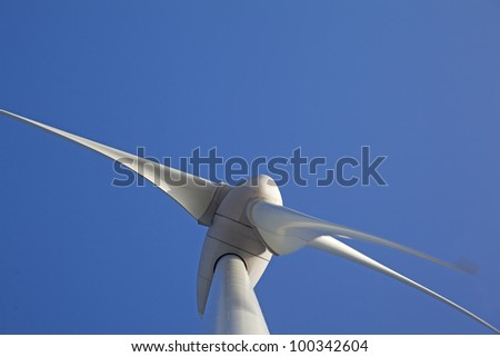 Close up of Wind turbine producing alternative energy - stock photo
