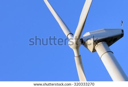 Close up of Wind Turbine producing alternative energy - stock photo