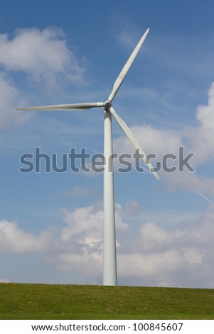 Close up of Wind turbine producing alternative energy on a dutch dike