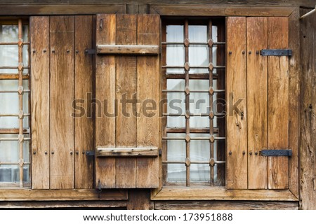 Close up of window with wooden shutter - stock photo