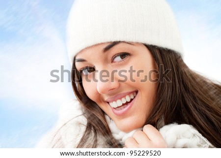 Close up of winter girl with attractive smile. - stock photo