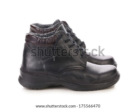 Close up of winter man's boots. Isolated on a white background.