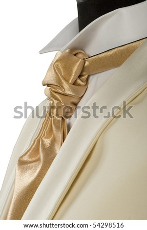 close-up of withe suit and gold tie for ceremony - stock photo