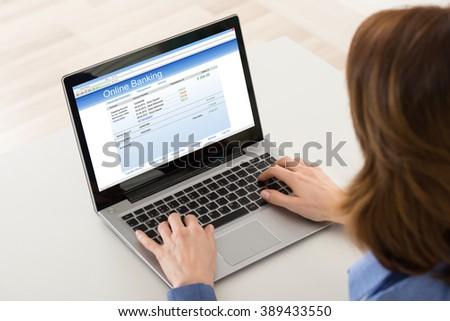Close-up Of Woman Banking Online On Laptop